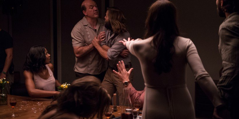 Pruitt (John Carroll Lynch) attempts to calm Will (Logan Marshall-Green) during a tense moment in Drafthouse Films' The Invitation. Courtesy of Drafthouse Films.