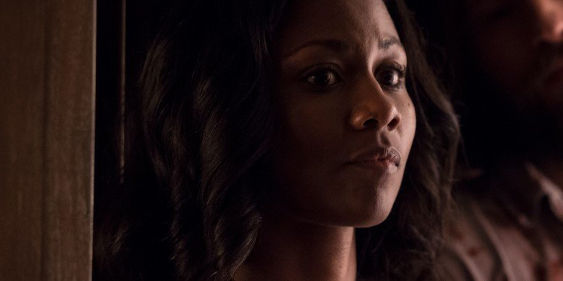 Kira (Emayatzy Corinealdi) anxiously looks on in Drafthouse Films' The Invitation. Courtesy of Drafthouse Films.