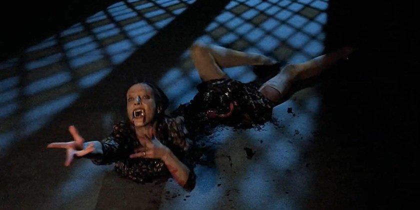 snake woman split in half writhing on the floor