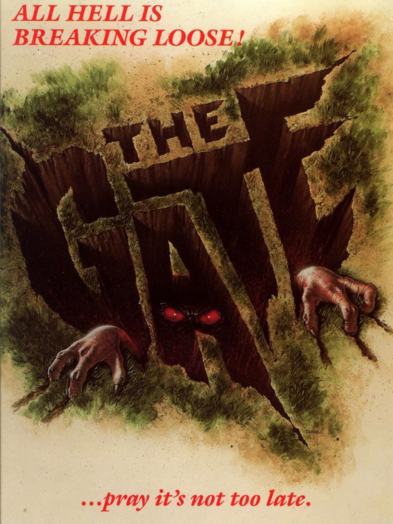 """Holes in the ground form the words """"The Gate"""" while red eyes and claws reach out from them"""